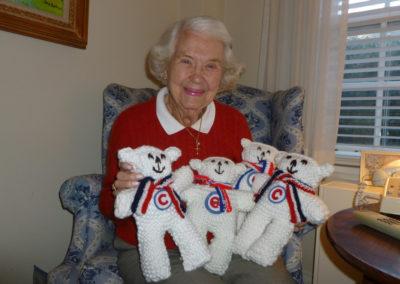 Elderly Woman Holding Stuffed Animals